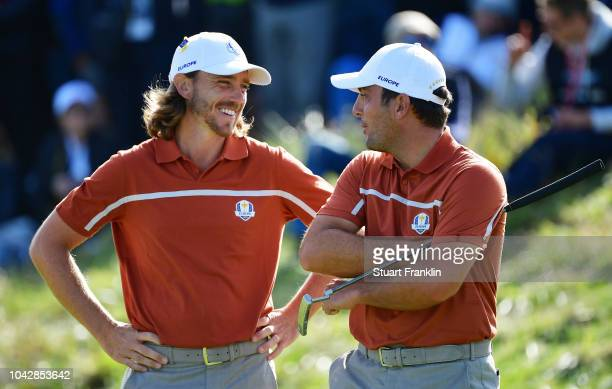 Tommy Fleetwood of Europe and Francesco Molinari of Europe in conversation during the afternoon foursome matches of the 2018 Ryder Cup at Le Golf...