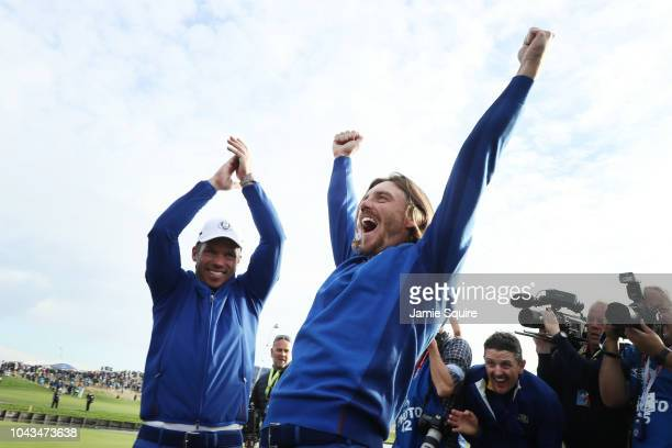 Tommy Fleetwood of Europe and Paul Casey of Europe celebrate winning The Ryder Cup during singles matches of the 2018 Ryder Cup at Le Golf National...