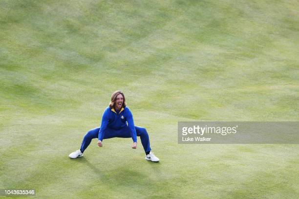 Tommy Fleetwood of Europe celebrates after winning The Ryder Cup during singles matches of the 2018 Ryder Cup at Le Golf National on September 30,...