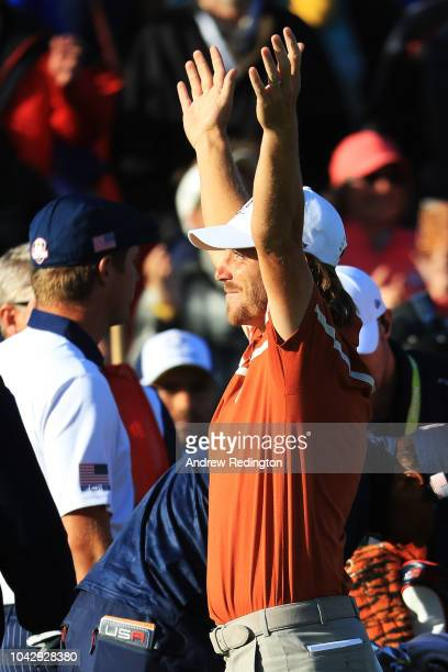 Tommy Fleetwood of Europe celebrates winning his match on the 14th during the afternoon foursome matches of the 2018 Ryder Cup at Le Golf National on...