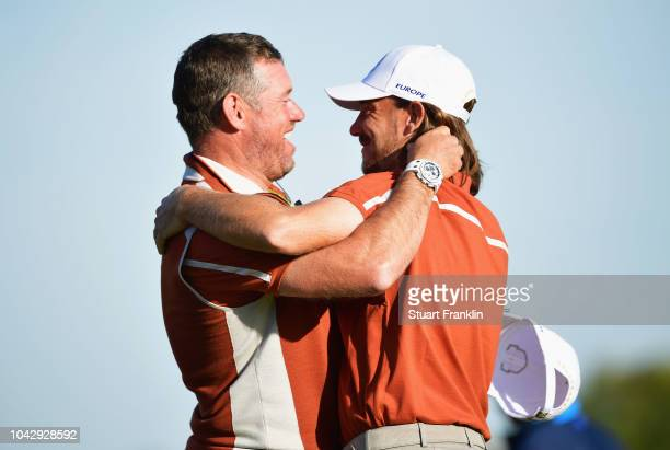 Tommy Fleetwood of Europe celebrates winning his match with ViceCaptain Lee Westwood of Europe on the 14th during the afternoon foursome matches of...
