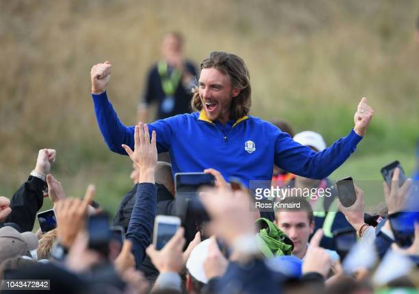 Tommy Fleetwood of Europe celebrates winning the Ryder Cup during singles matches of the 2018 Ryder Cup at Le Golf National on September 30, 2018 in...
