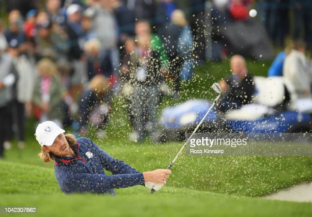 Tommy Fleetwood of Europe plays out of a bunker on the second during the morning fourball matches of the 2018 Ryder Cup at Le Golf National on...