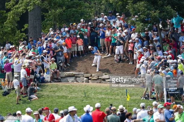Tommy Fleetwood plays a shot in the crowd on the 11th hole during the PGA Championship August 12 at Bellerive Country Club in St Louis MO