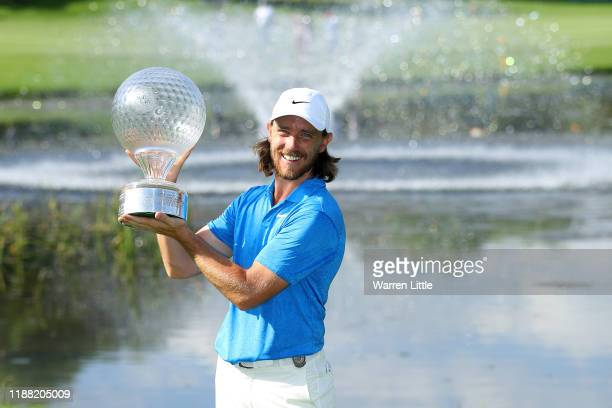 Tommy Fleetwood poses for a photo with the Nedbank Golf Challenge Trophy after victory during the fourth round of the Nedbank Golf Challenge hosted...