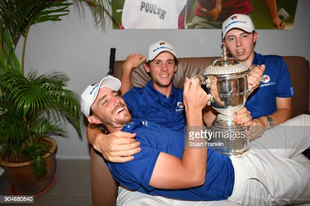 Tommy Fleetwood Thomas Pieters and Matthew Fitzpatrick of Europe celebrate with the trophy following their team's victory during the singles matches...