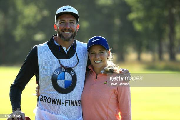 Tommy Fleetwood's caddy, Ian Finnis poses with wife Rachel Brown-Finnis as he caddies for her during the BMW PGA Championship Pro-Am at Wentworth...