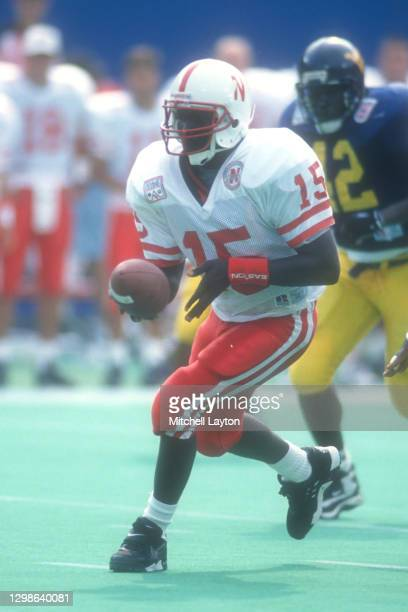 Tommy Frazier of the Nebraska Cornhuskers looks to hand off the ballduring a college football game against the West Virginia Mountaineers on August...