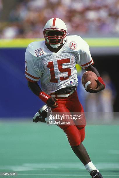 Tommy Frazier of the Nebraska Cornhuskers runs with the ball during a college football game against the West Virginia Mountaineers on August 31, 1994...