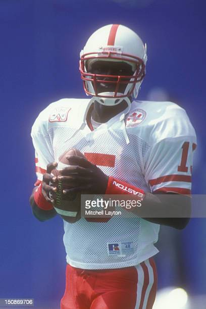 Tommy Frazier of the Nebraska Cornhuskers warms up before a college football game against the West Virginia Mountaineers on August 31, 1994 at Giants...