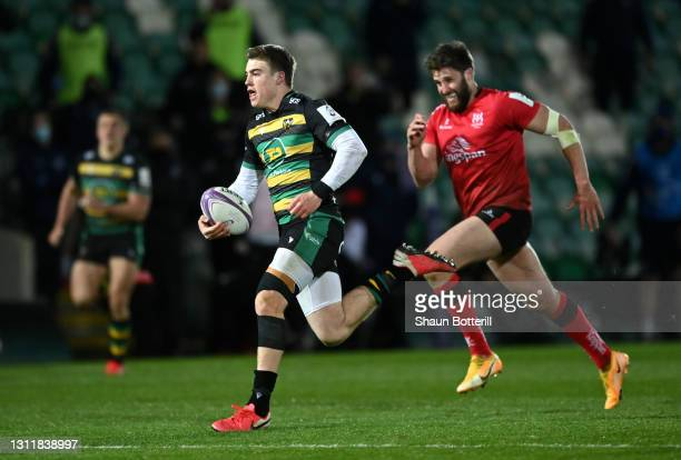 Tommy Freeman of Northampton Saints breaks through to score their third try during the European Rugby Challenge Cup match between Northampton Saints...
