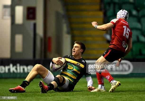 Tommy Freeman of Northampton Saints celebrates after scoring their third try during the European Rugby Challenge Cup match between Northampton Saints...