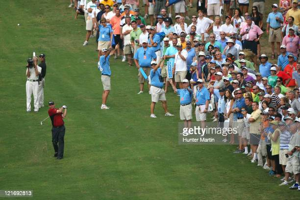 Tommy Gainey hits his second shot on the 18th hole during the final round of the Wyndham Championship at Sedgefield Country Club on August 21, 2011...