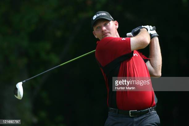 Tommy Gainey hits his tee shot on the 14th hole during the final round of the Wyndham Championship at Sedgefield Country Club on August 21, 2011 in...