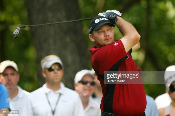Tommy Gainey hits his tee shot on the second hole during the final round of the Wyndham Championship at Sedgefield Country Club on August 21, 2011 in...