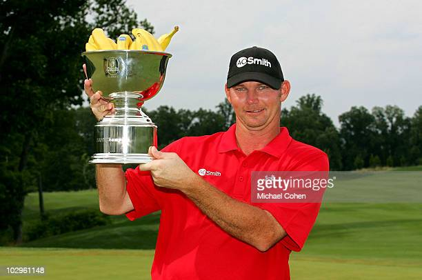 Tommy Gainey holds the trophy after winning the Chiquita Classic held at TPC River's Bend on July 18 2010 in Cincinnati Ohio