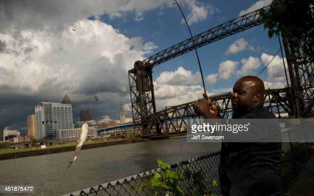 Tommy Greer fishes in the Cuyahoga River with a background of downtown Cleveland which has been chosen for the 2016 Republican National Convention on...