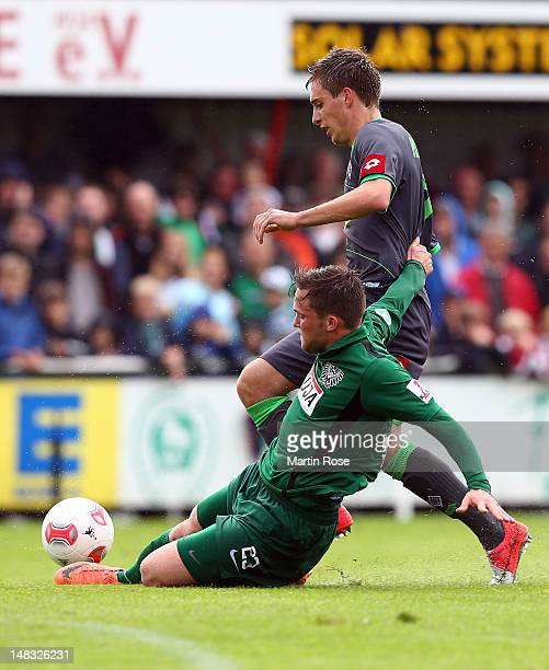Tommy Grupe of Muenster and Patrick Herrmann of Gladbach battle for the ball during the friendly match between Preussen Muenster and Borussia...