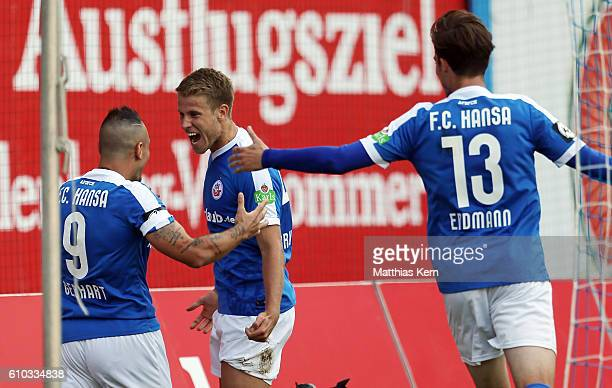 Tommy Grupe of Rostock jubilates with team mates after scoring the second goal during the third league match between FC Hansa Rostock and FSV Zwickau...