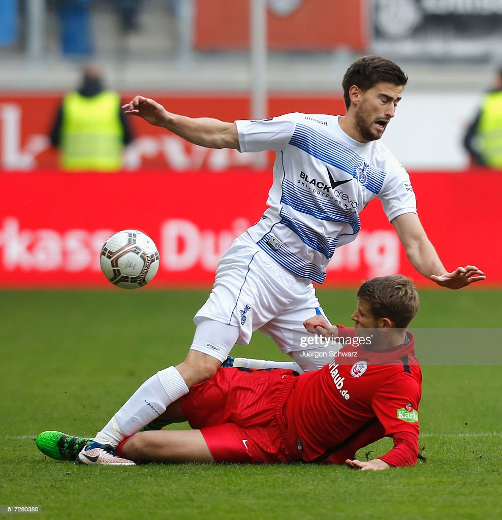 Tommy Grupe of Rostock (R) tackles Dustin Bomheur of Duisburg during the third league match between MSV Duisburg and Hansa Rostock at Schauinsland-Reisen-Arena on October 22, 2016 in Duisburg, Germany.