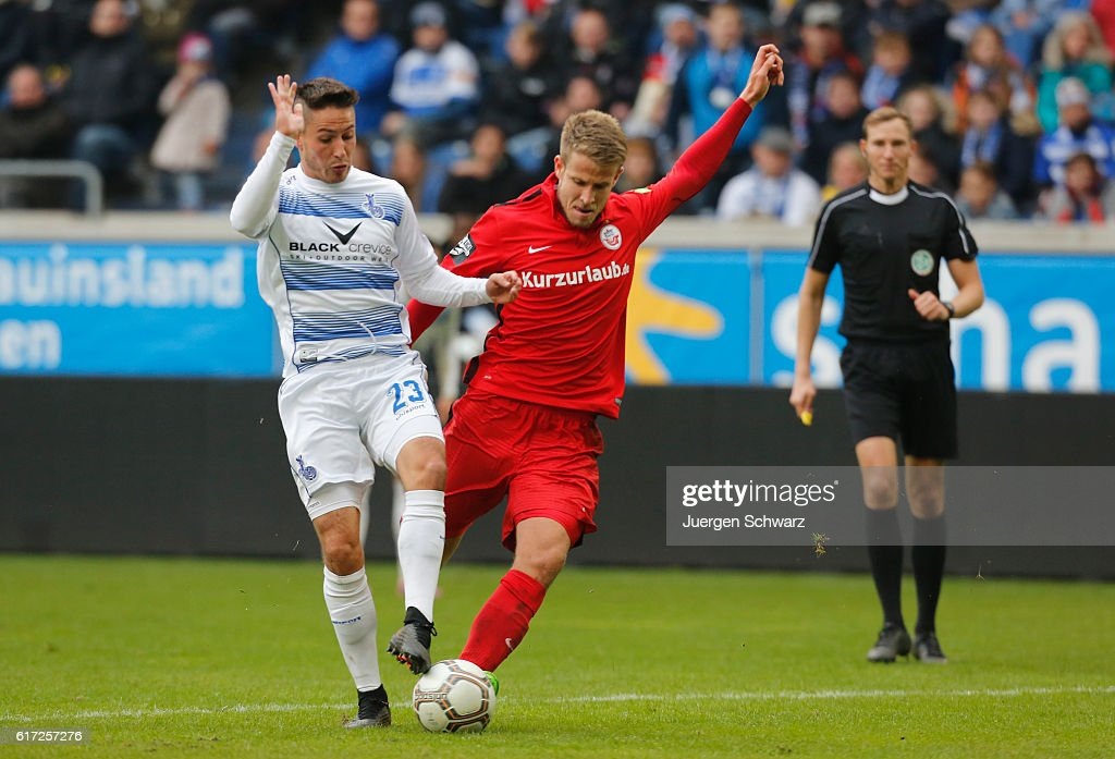 Tommy Grupe of Rostock (R) tackles Fabian Schnellhardt of Duisburg during the third league match between MSV Duisburg and Hansa Rostock at Schauinsland-Reisen-Arena on October 22, 2016 in Duisburg, Germany.