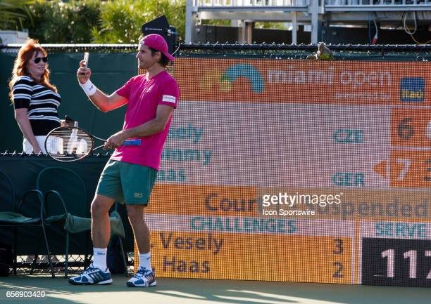 Tommy Haas and a visiting Iguana during a break in the action at the Miami Open on March 22 at the Tennis Center at Crandon Park in Key Biscayne FL