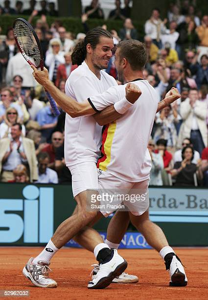 Tommy Haas and Alexander Waske of Germany celebrate winning their doubles match against Guillermo Canas and Guillermo Coria of Argentina and...
