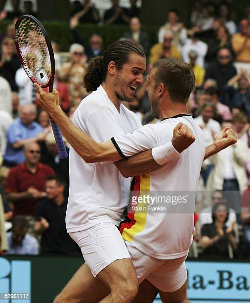 Tommy Haas and Alexander Waske of Germany celebrate winning their double match and the overall title against Guillermo Canas and Guillermo Coria of...