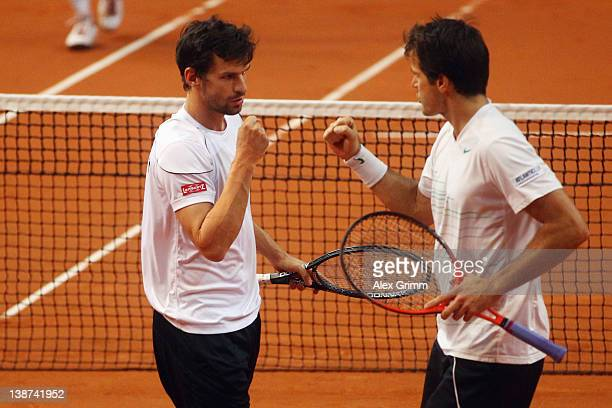 Tommy Haas and Philipp Petzschner of Germany celebrate during their doubles match on day 2 of the Davis Cup World Group first round match between...