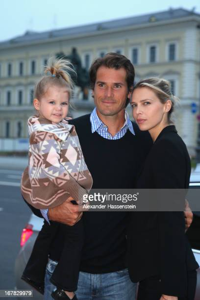 Tommy Haas arrives with his daughter Valentina and Sara Foster for the BMW Open Players Night at Lazy Moon Dinner Club on April 30, 2013 in Munich,...