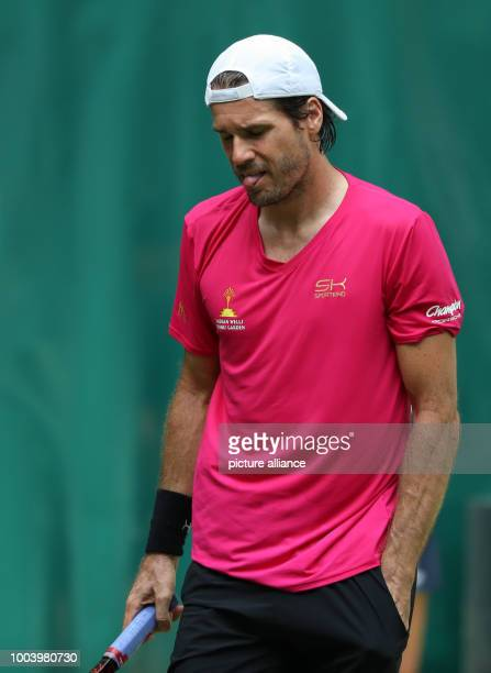Tommy Haas from Germany sticks his tongue out during the men's singles first round tennis match against Austria's Tomic at the ATP tournament taking...