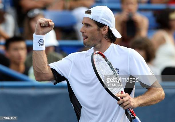 Tommy Haas of Germany celebrates after defeating Juan Carlos Ferrero of Spain during Day 4 of the Legg Mason Tennis Classic at the William H.G....
