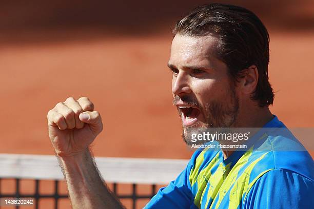 Tommy Haas of Germany celebrates victory after his quarter final match against Marcos Baghadatis of Cyprus at BMW Open at Iphitos tennis club on May...