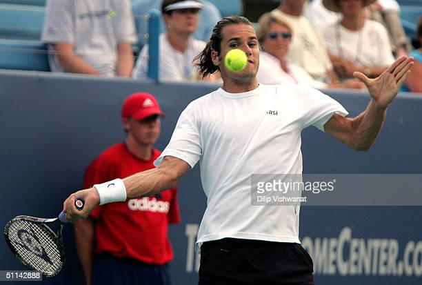 Tommy Haas of Germany hits a forehand against Sargis Sargsian of Armenia during the Western and Southern Financial Group Masters tournament August 4...