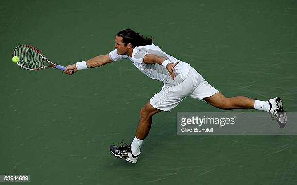 Tommy Haas of Germany hits a shot to Rainer Schuettler of Germany during the second round of the US Open at the USTA National Tennis Center in...