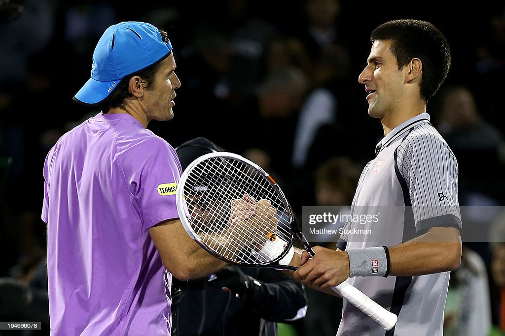 Tommy Haas of Germany is congratulated by Novak Djokovic of Serbia after their match during the Sony Open at Crandon Park Tennis Center on March 26, 2013 in Key Biscayne, Florida.