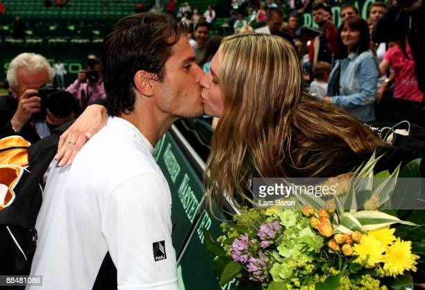 Tommy Haas of Germany kisses his girlfriend Sara Foster an American actress after winning the final of the Gerry Weber Open against Novak Djokovic of...
