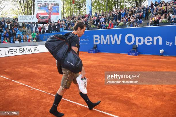 Tommy Haas of Germany leaves the centre court in a tradiotional Bavarian leather pants after his 2 round match against JanLennard Sruff of Germany...