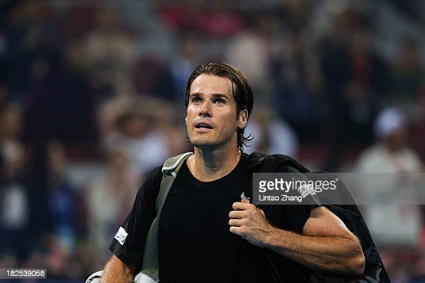 Tommy Haas of Germany leaves the court after losing to Lleyton Hewitt of Australia during day three of the 2013 China Open at National Tennis Center...