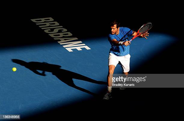 Tommy Haas of Germany plays a backhand against Marinko Matosevic of Australia during day three of the 2012 Brisbane International at Pat Rafter Arena...