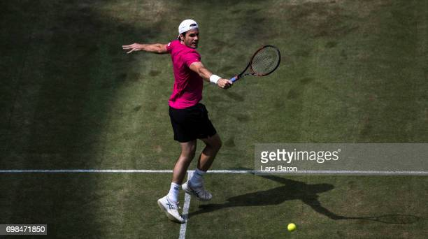 Tommy Haas of Germany plays a backhand during his match against Bernard Tomic of Australia during Day 4 of the Gerry Weber Open 2017 at on June 20...