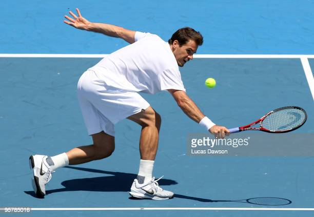 Tommy Haas of Germany plays a backhand in his third round match against Jo-Wilfried Tsonga of France during day three of the 2010 Kooyong Classic at...