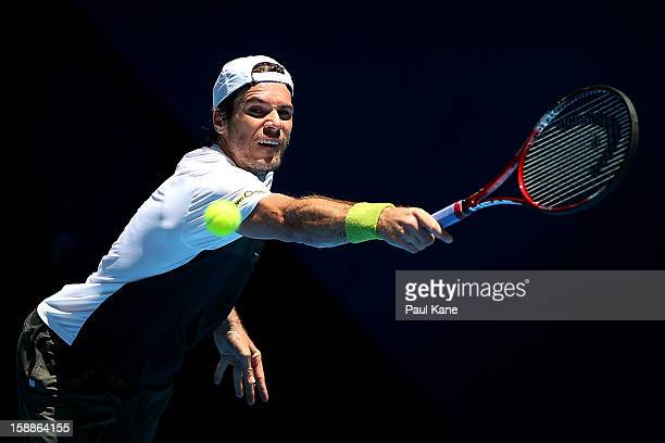 Tommy Haas of Germany plays a backhand to Andreas Seppi of Italy in his singles match during day five of the Hopman Cup at Perth Arena on January 2...