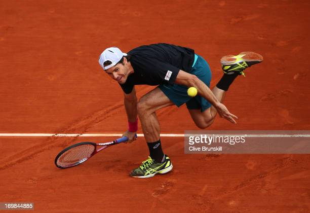 Tommy Haas of Germany plays a forehand during his Men's Singles match against Mikhail Youzhny of Russian Federation on day nine of the French Open at...