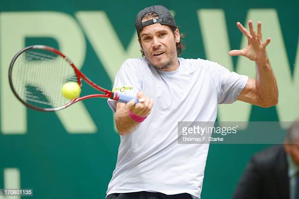 Tommy Haas of Germany plays a forehand in his half final match against Roger Federer of Switzerland during day six of the Gerry Weber Open at Gerry...
