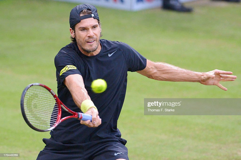 Tommy Haas of Germany plays a forehand in his match against Ernests Gulbis of Latvia during day four of the Gerry Weber Open at Gerry Weber Stadium on June 13, 2013 in Halle, Germany.