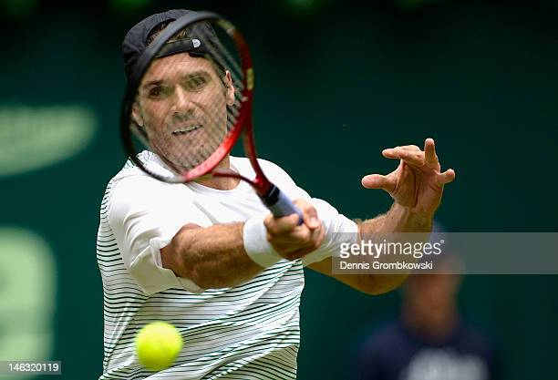 Tommy Haas of Germany plays a forehand in his round of 16 match against Marcel Granollers of Spain during day four of the Gerry Weber Open at Gerry...