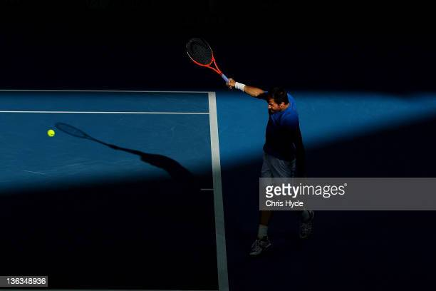 Tommy Haas of Germany plays a shot against Marinko Matosevic of Australia during day three of the 2012 Brisbane International at Pat Rafter Arena on...