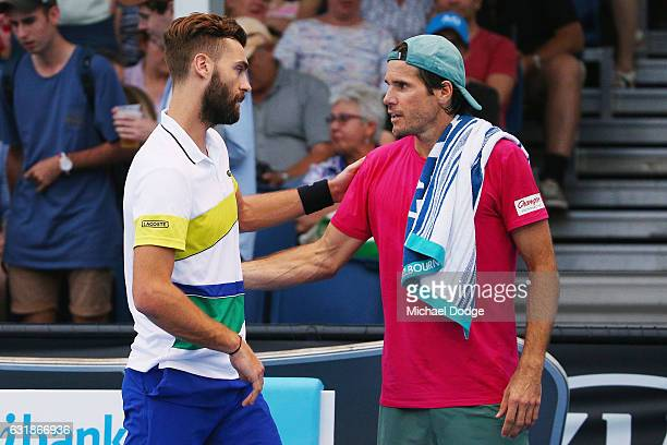 Tommy Haas of Germany retires in his first round match against Benoit Paire of France on day two of the 2017 Australian Open at Melbourne Park on...