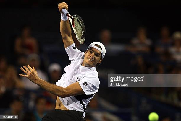 Tommy Haas of Germany returns a shot against Frank Dancevic of Canada during Day 2 of the Legg Mason Tennis Classic at the William H.G. FitzGerald...